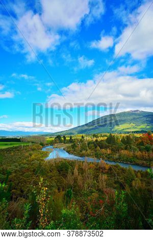 Bright Autumn Day At The Banks Of Tongariro River With Magnificent Mountains At The Horizon. North I