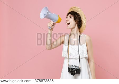 Excited Young Tourist Woman In Dress Hat With Photo Camera Isolated On Pink Background. Traveling Ab
