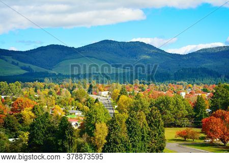 Bright And Sunny Autumn Day In Turangi Town With Magnificent Mountains Of Tongariro National Park In