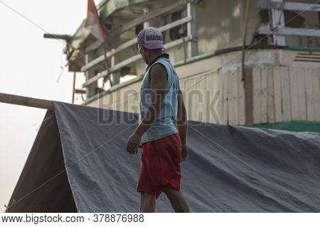 Jakarta, Sunda Kelapa Port, Indonesia - July 15, 2019: A Man Inspects The Cargo Of A Ship In The Por