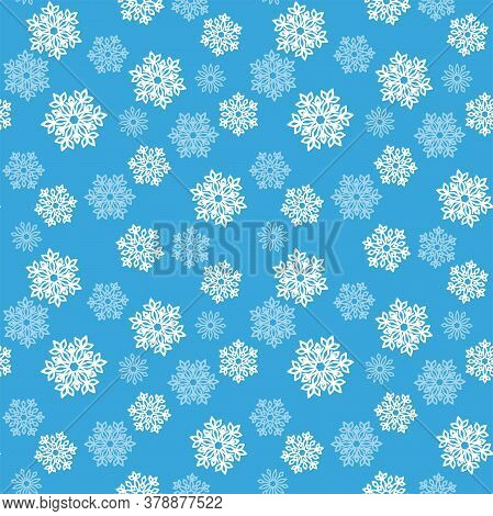 White And Pale Blue Openwork Snowflakes On A Blue Background. Vector Seamless Pattern For Festive De