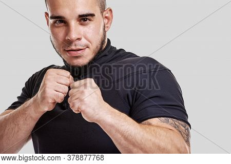 Portrait Of Young Muscular Powerful Kick-boxer Practicing Kick