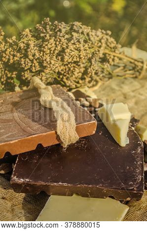 Dark , Milk And White Comemade Chocolate Factory Background. Delicious Chocolate Pieces