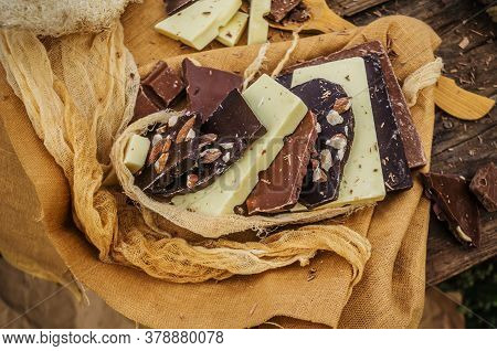 Chocolate Mix On Rustic Wooden Background