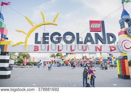 Billund, Denmark, July 2018: Young Family Make A Selfie At The Entrance To Legoland Amusement Park
