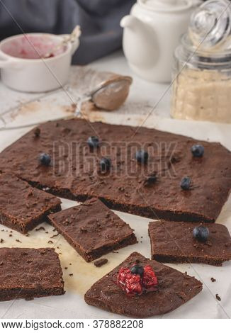 Homemade Mediterranean Chocolate Brownies Cut Into Pieces With Raspberry And Blueberry Placed On A P