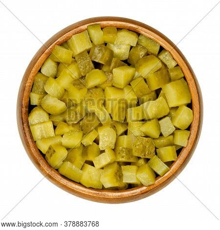 Pickled Cucumber, Diced, Also Known As Pickle Or Gherkin, In Wooden Bowl. Small Pickled Cucumbers Wi
