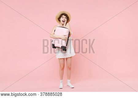 Shocked Young Tourist Woman In Summer White Dress Hat Isolated On Pink Background. Female Traveling