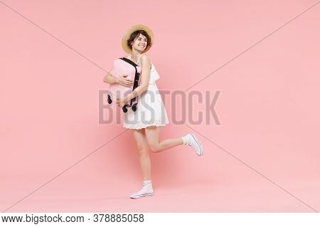 Smiling Young Tourist Woman In Summer White Dress Hat Isolated On Pink Background Studio. Female Tra