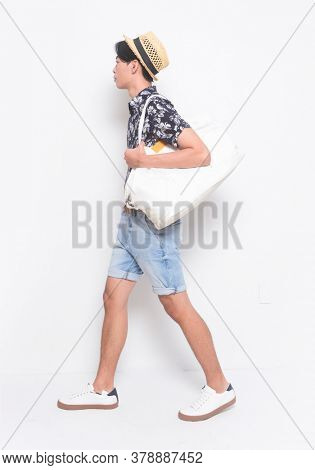 Full body Man casual wearing new stylish floral, plant ,leaves fern printed sleeve shirts with hat , holding handbag runway in studio