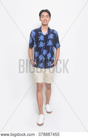Full body Summer man casual wearing new stylish coconut tree printed t-shirt with white pants short ,runway in studio