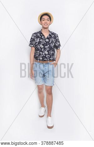 Full body Man casual wearing new stylish floral, plant ,leaves fern printed sleeve shirts with blue pants runway in studio