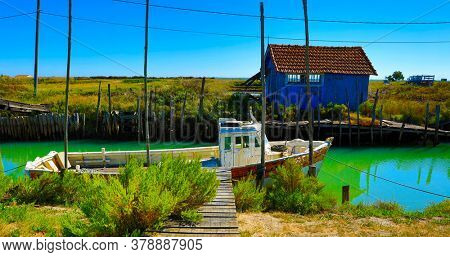 multicolored oyster shed and boat at Oleron Island