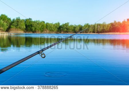 Fishing Rod On The Boat. A Fishing Rod Is A Long, Flexible Rod Used By Fishermen To Catch Fish. Fish