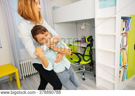 Close Portrait Of Little Autistic Boy Bite Hands With Strong Negative Face Expression, Throwing Tant