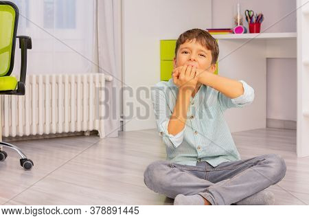 Little Autistic Boy Bite Hands With Strong Negative Face Expression Sitting In His Room, Self-injury