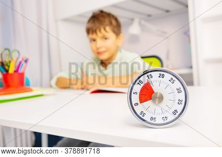 Timer And Little Boy During Development Therapy Lesson On Background