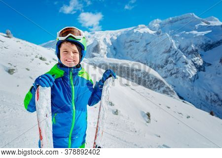 Happy Boy With Ski Standing In Confident Way Over Mountains Mask Up Smiling And Looking At Camera