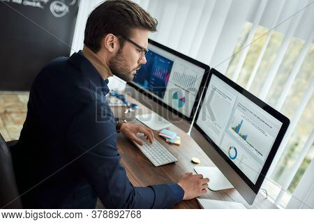 Preparing Statistical Report. Focused Businessman Or Financial Analyst Working In The Modern Office,