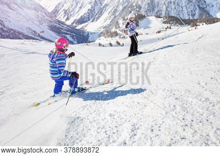 Two Sisters Ski Downhill On Mountain Winter Resort Slop