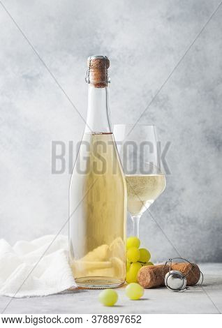 Glass And Bottle Of White Homemade Wine With Grapes And Corkscrew With Linen Cloth On Light Table Ba
