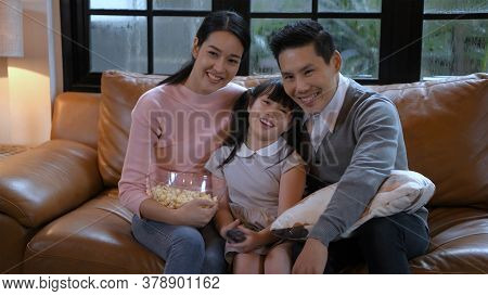 Family Concept. An Asian Family Is Watching Television Inside The House. 4k Resolution.