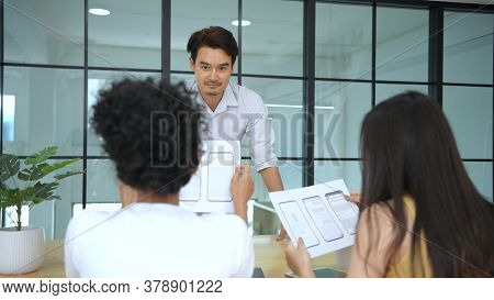 Business Concepts. A Young Asian Man Is Presenting Ideas At The Meeting. 4k Resolution.