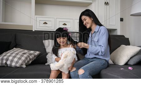 Family Concept. Mother Is Combing The Hair For The Children In The House. 4k Resolution.
