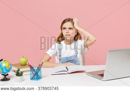 Preoccupied Puzzled Little Kid Schoolgirl 12-13 Years Old Study At White Desk With Pc Laptop Isolate