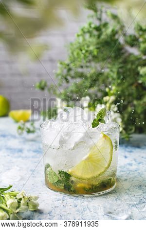 Summer Refreshing Ice Cocktail With Lime And Mint, Mojito Or Lemonade, Copy Space