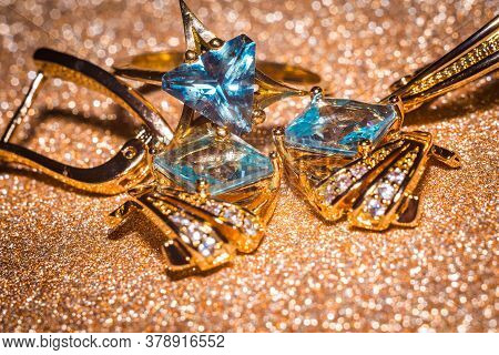 Gold Earrings With Light Blue Zirconia
