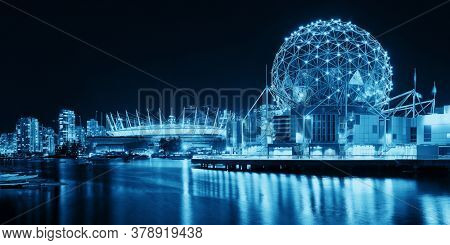 VANCOUVER, BC - AUG 17: Science World at night with boat on August 17, 2015 in Vancouver, Canada. With 603k population, it is one of the most ethnically diverse cities in Canada.