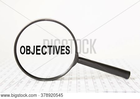 Magnifying Glass With An Inscription In The Middle Objectives. Finance
