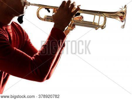 Man Playing Trumpet in studio