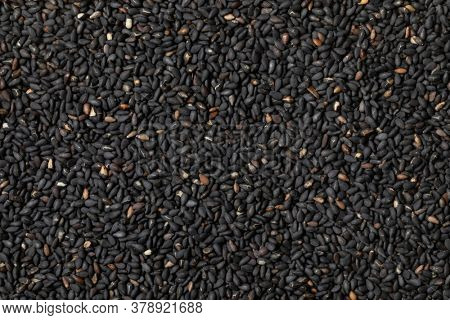Black roasted sesame seeds close up full frame