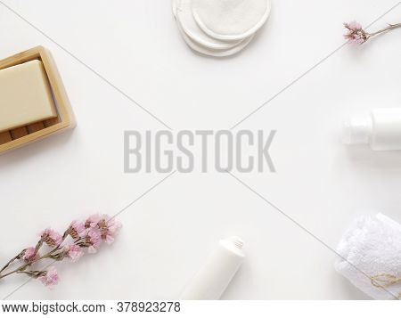 Care Products Cream, Lotion, Cotton Pads, Plant, Soap, Towel. Bath Accessories On White Background,
