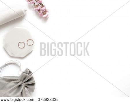 Care Products Cream, Plant, Towel, Rings. Bath Accessories On White Background, Top View. Bodycare B
