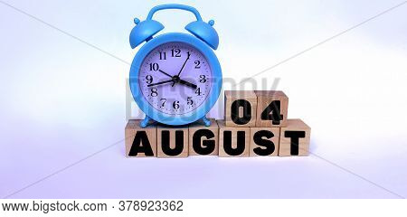 August 4.august 4 On Wooden Cubes On A White Background.blue Watch.photos For The Holiday .the Last