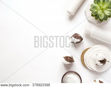 Care Products Cream, Lotion, Cotton, Pads, Plant, Towel. Bath Accessories On White Background, Top V