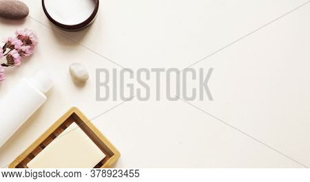 Care Products Lotion, Plant, Soap, Stone. Bath Accessories On Bright Background, Top View, Copyspace