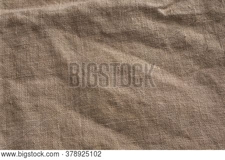Sackcloth Burlap Woven Texture Background. Organic Linen Fabric Textile In Beige Sepia Brown Color.