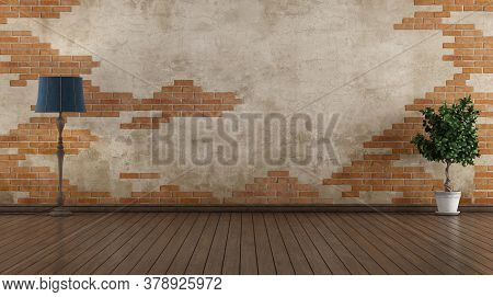 Empty Old Room With Brickwall,floor Lamp And Houseplant - 3d Rendering