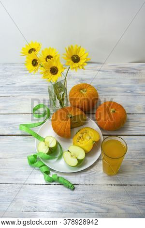 Low Calorie Diet Food On Wooden Background. Apple, Pumpkin And Fresh Juice In A Glass. Nearby Are Ye