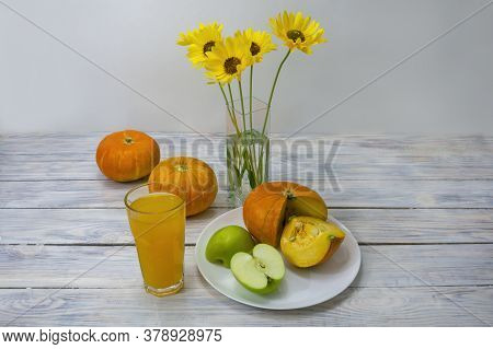 Food For Low Calorie Diet. Pumpkin, Green Apple And Fresh Juice On Wooden Table. The Concept Of Deto