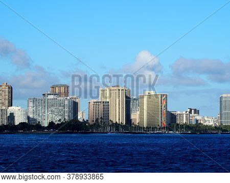 Honolulu - July 6, 2019: Ala Moana Boat Harbor, Ilikai Hotel, Hilton Hawaiian, Other Waikiki Hotels