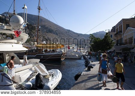 Symi / Greece / August 14 2009 : The Beautiful Holiday Island Of Symi, Greece. Pleasure Boats At The