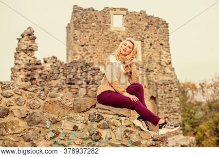 Travel Destinations. Woman Makeup Face Sit On Stony Ruins Background Defocused. Tourism Concept. Exp