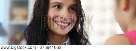 Portrait Of Happy Woman With Funny Pink Piggy Bank. Cheerful Little Daughter Gifting Moneybox To Mum
