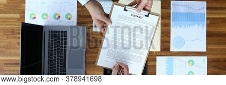 Top View Of Businessman Hand Signing Contract. Business People Making Profitable International Barga