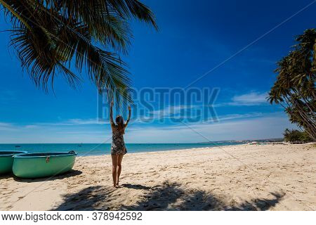 Young Sexi Woman On Palm In Vietnam